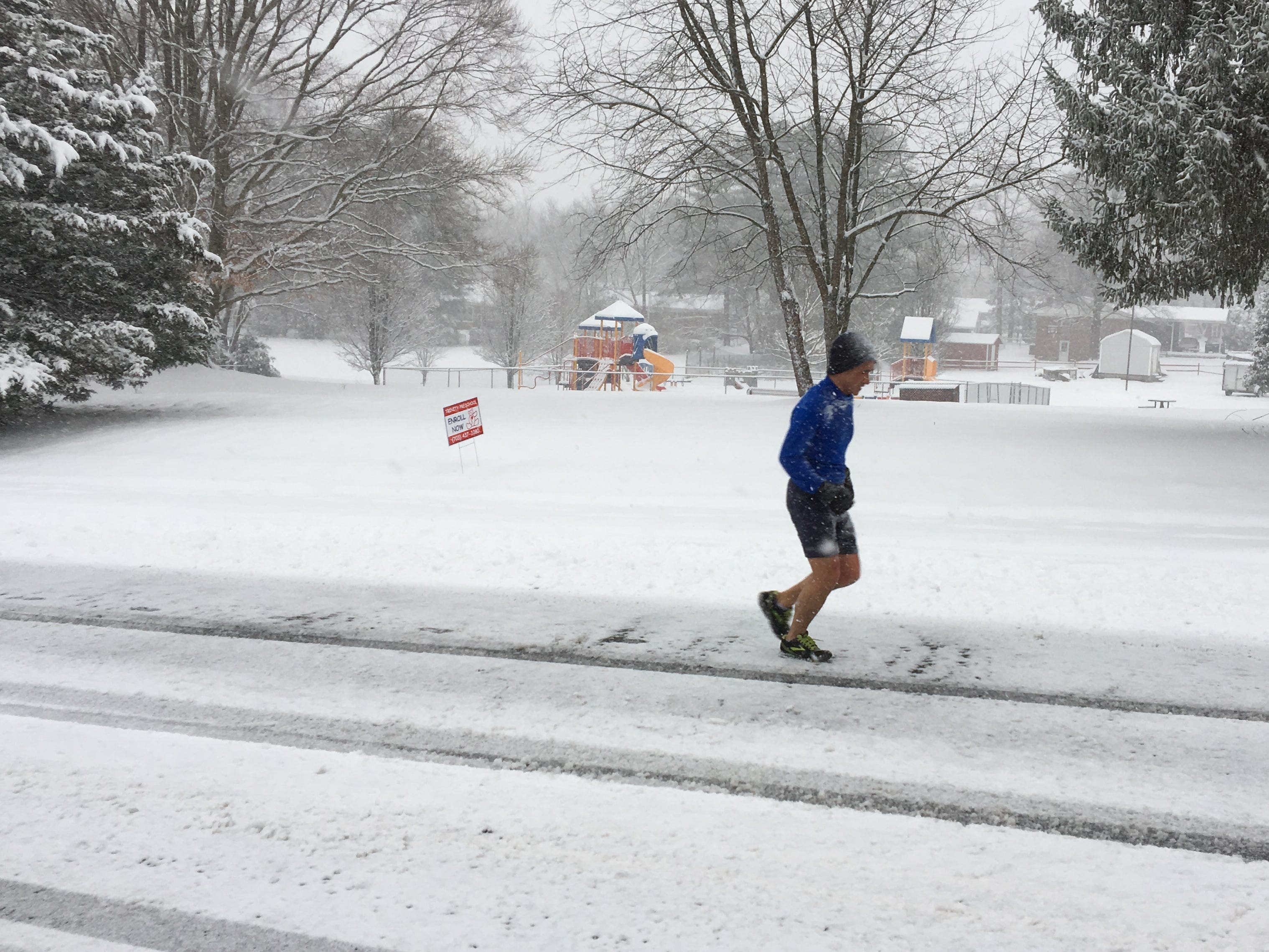This diehard runner is out during a snow storm in Herndon, Va Feb. 20, 2019 as several inches of snow are predicted for the area around the metro Washington, DC, area.