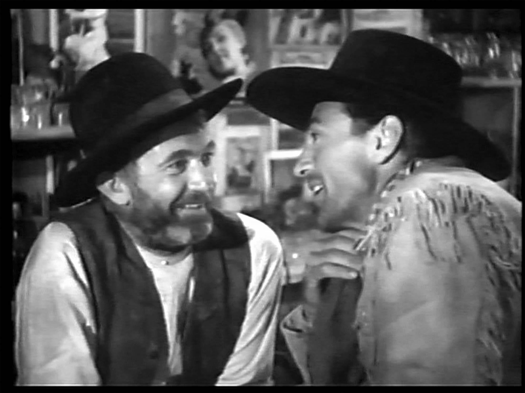 Walter Brennan, left, and Gary Cooper in a scene from 'The Westerner,' used in the documentary The Silver Screen: Color Me Lavender.