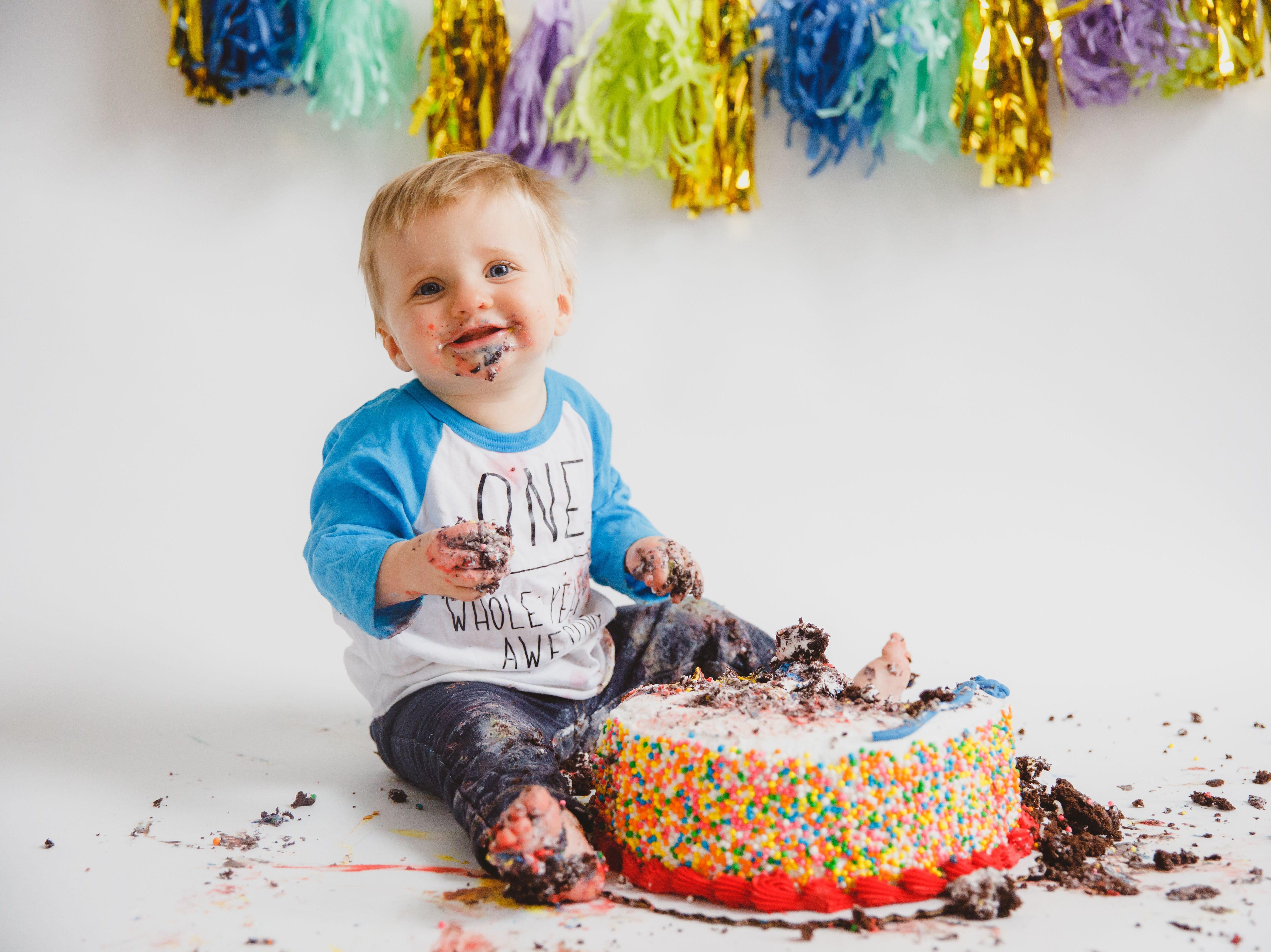 Enzo smashes his first birthday cake.