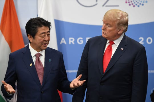 President Donald Trump and Japanese Prime Minister Shinzo Abe speak at last year's G-20 summit in Buenos Aries.
