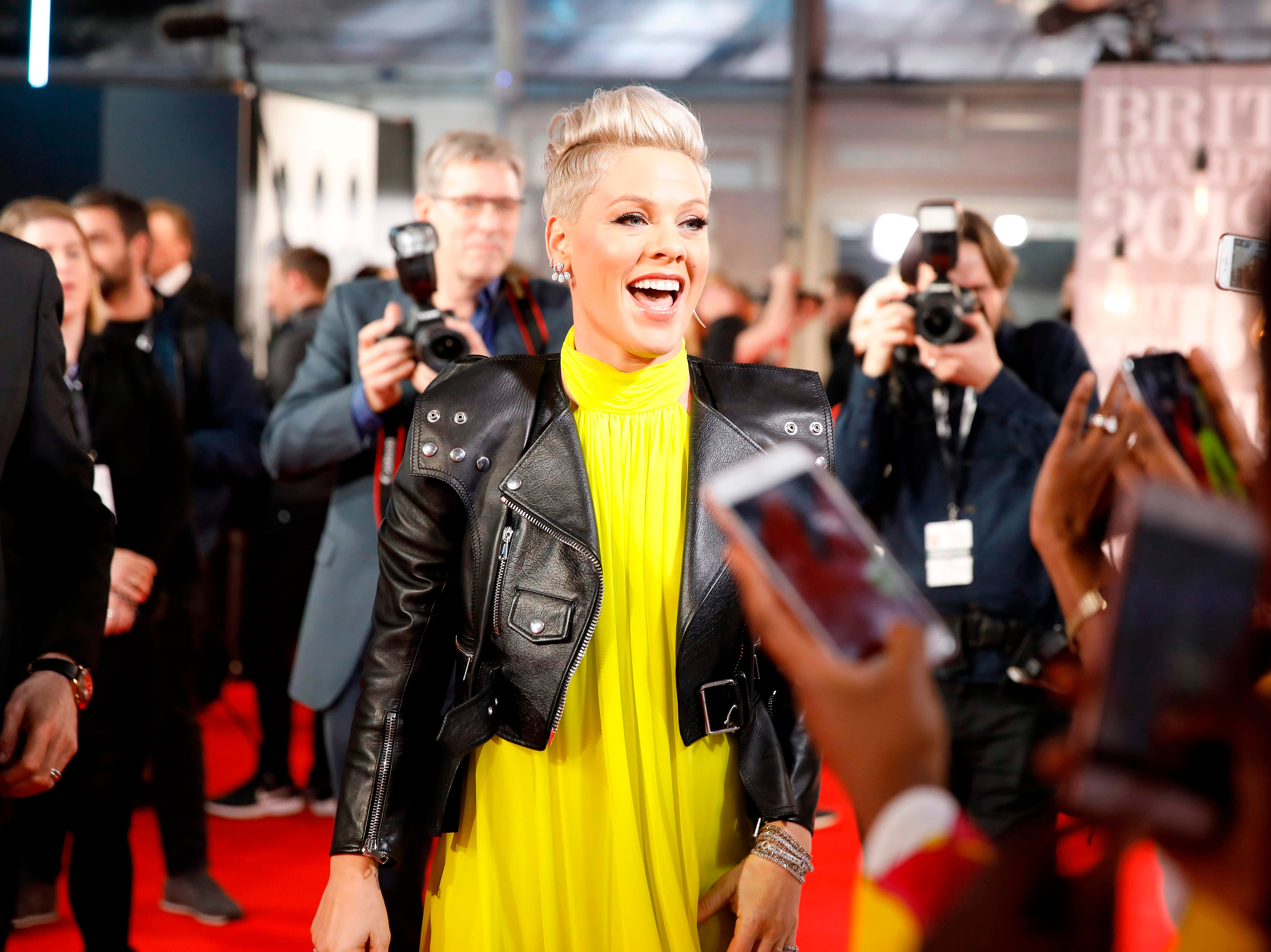 US singer-songwriter Pink reacts on the red carpet on arrival for the BRIT Awards 2019 in London on February 20, 2019. (Photo by Tolga AKMEN / AFP) / RESTRICTED TO EDITORIAL USE  NO POSTERS  NO MERCHANDISE NO USE IN PUBLICATIONS DEVOTED TO ARTISTSTOLGA AKMEN/AFP/Getty Images ORIG FILE ID: AFP_1DO25U
