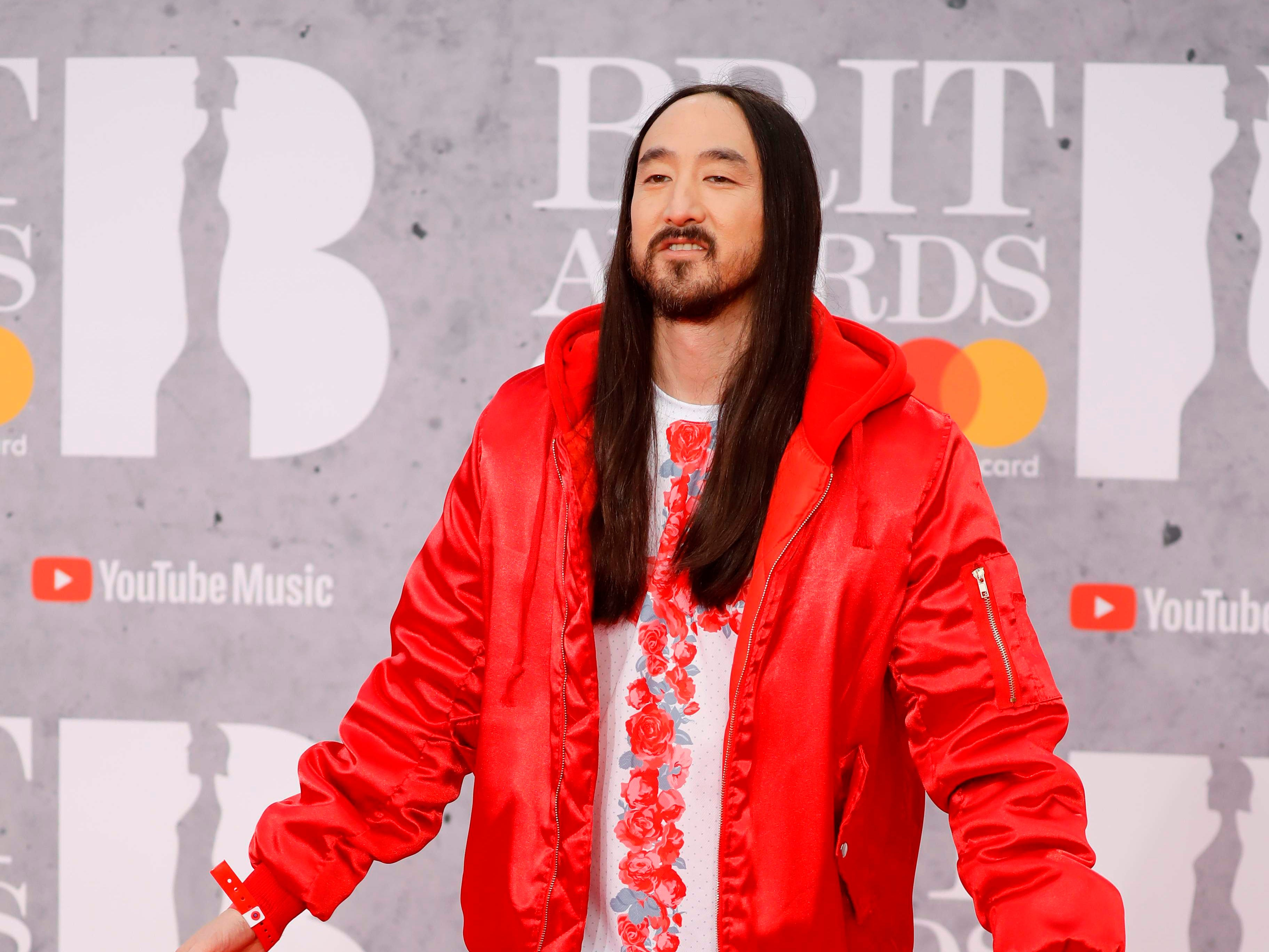 US musician Steve Aoki poses on the red carpet on arrival for the BRIT Awards 2019 in London on February 20, 2019. (Photo by Tolga AKMEN / AFP) / RESTRICTED TO EDITORIAL USE  NO POSTERS  NO MERCHANDISE NO USE IN PUBLICATIONS DEVOTED TO ARTISTSTOLGA AKMEN/AFP/Getty Images ORIG FILE ID: AFP_1DO07N