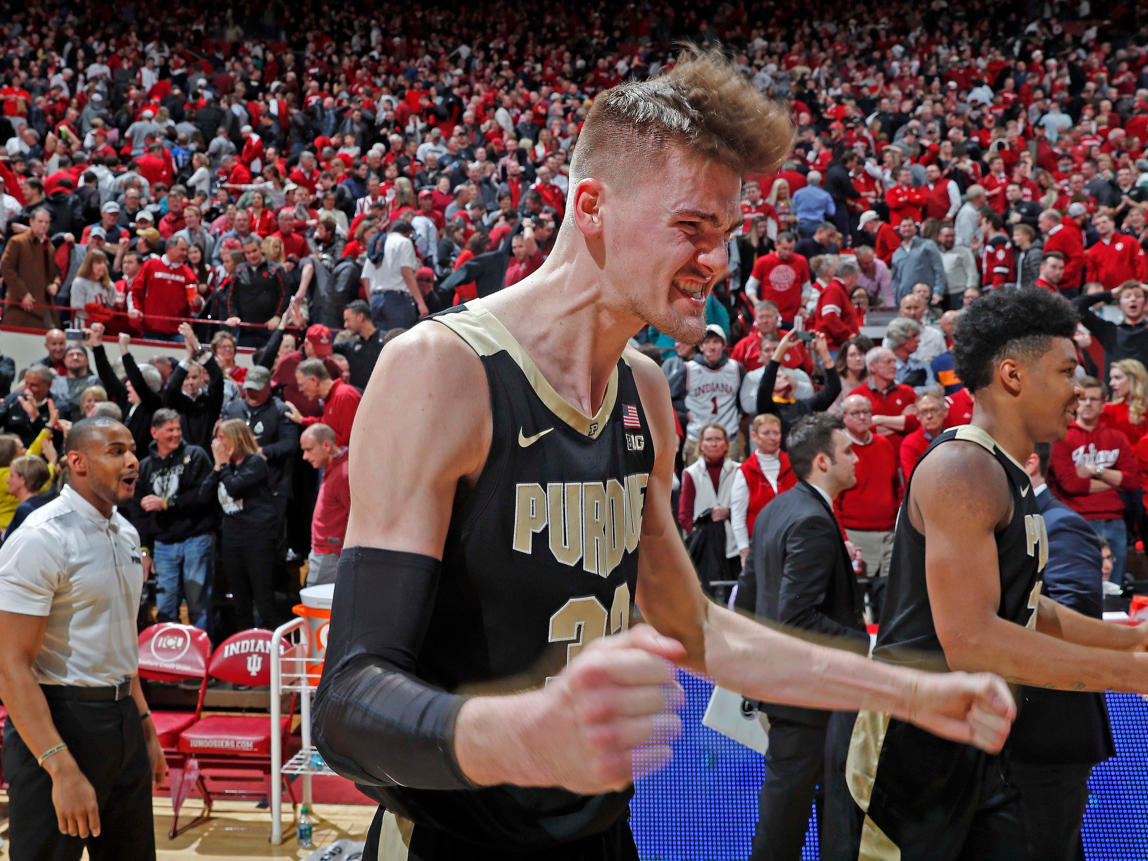 Purdue center Matt Haarms (32) reacts after hitting the game-winning shot against Indiana as stunned Hoosiers fans look on.