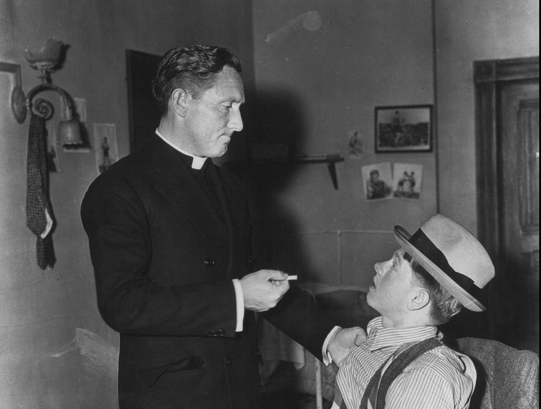 """Spencer Tracy & Mickey Rooney in the 1939 film """"Boys Town""""."""