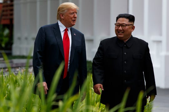 President Donald Trump walks with North Korean leader Kim Jong Un during their first summit in Singapore on June 12. The two leaders will meet again in Vietnam on Feb. 27 and 28th.