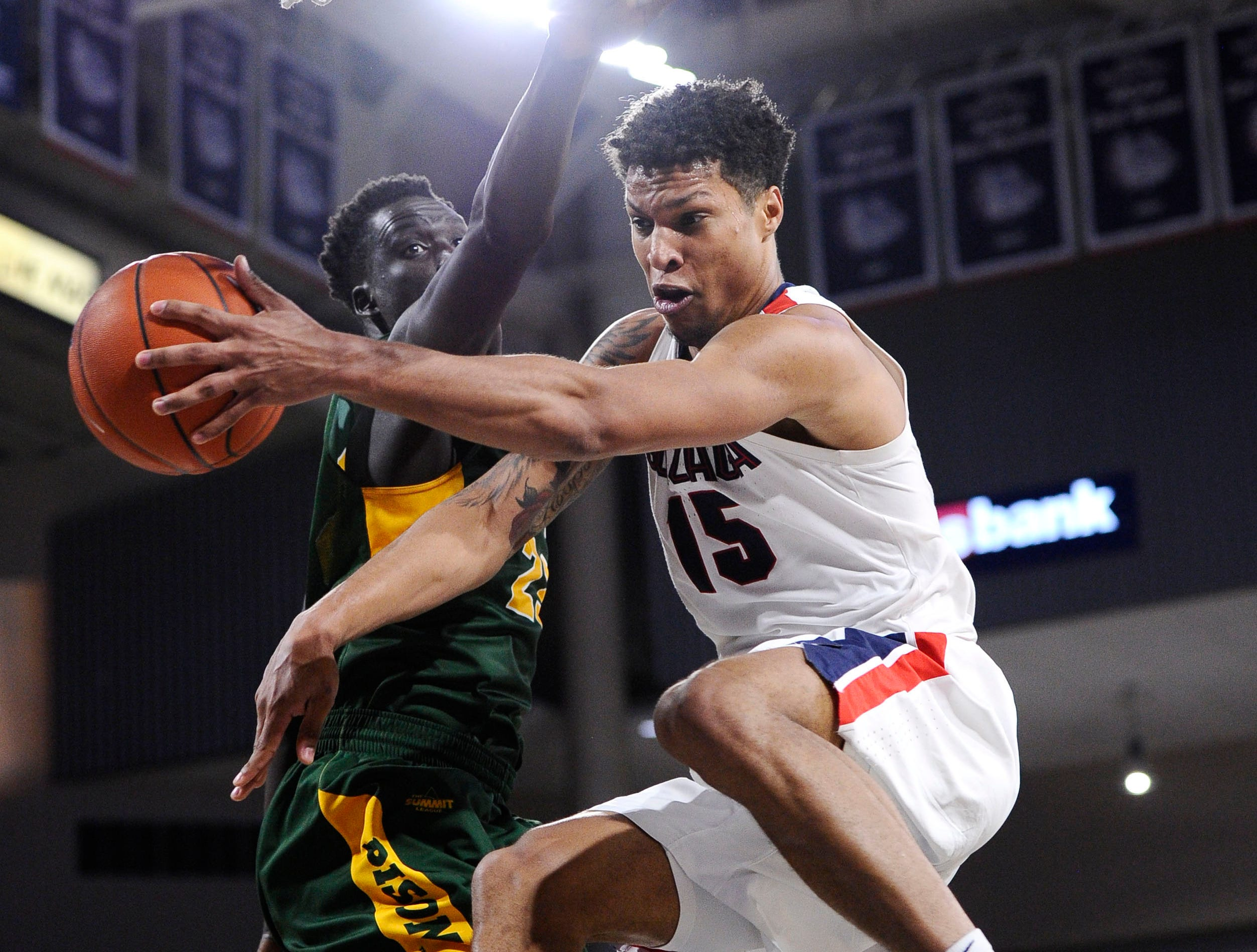 Nov. 26: Gonzaga Bulldogs forward Brandon Clarke (15) passes the basketball around North Dakota State Bison forward Deng Geu (23) in the second half at McCarthey Athletic Center.