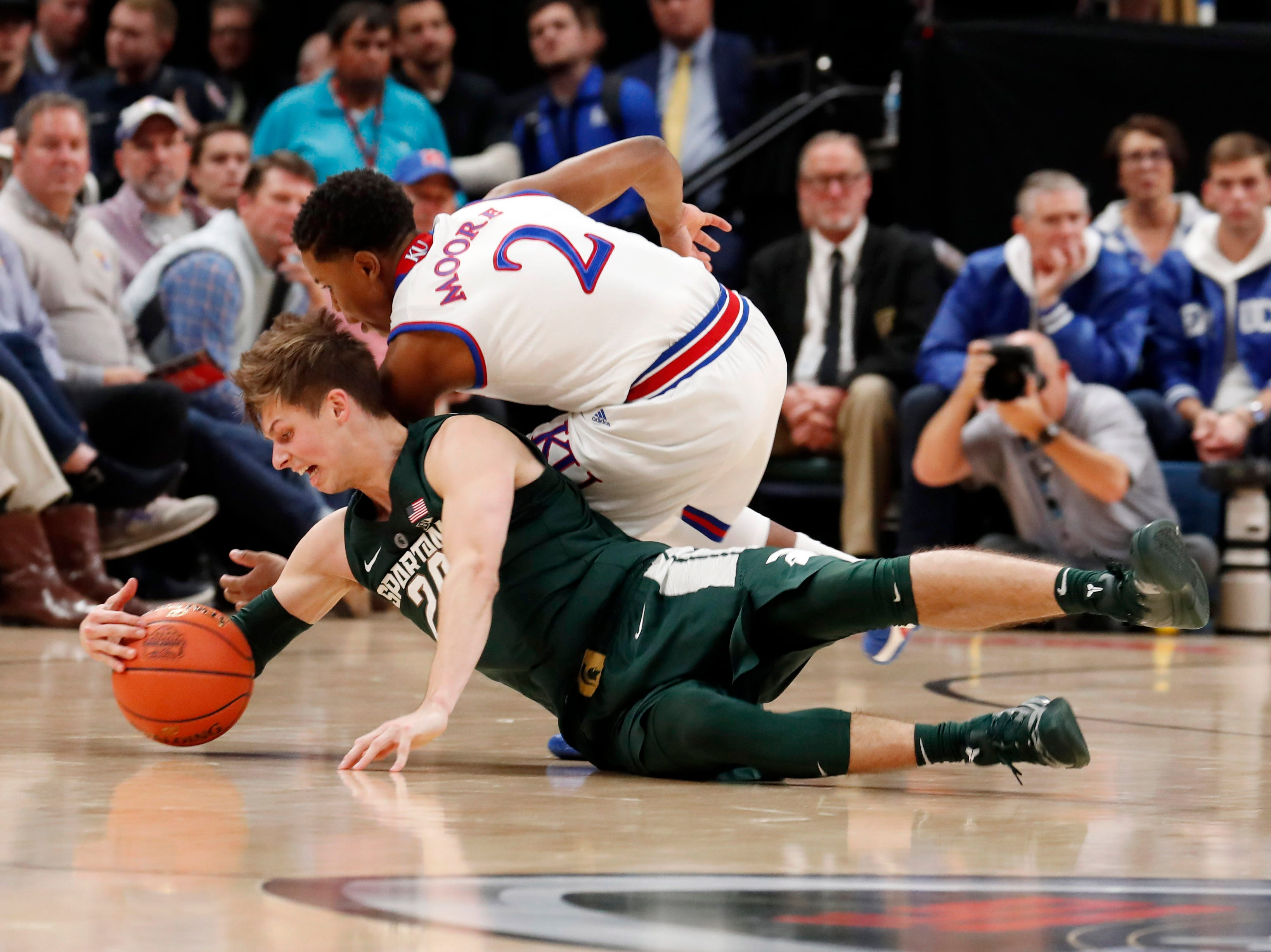 Nov. 6: Michigan State Spartans guard Matt McQuaid (20) scrambles for a loose ball against Kansas Jayhawks guard Charlie Moore (2) in the first half of the Champions Classic.