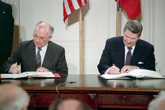 A handout photo made available by the Ronald Reagan Presidential Library Museum shows President Ronald Reagan and Soviet General Secretary Michhail Gorbachev signing the INF Treaty in the East Room of the White House in Washington D.C., Dec. 8, 1987.