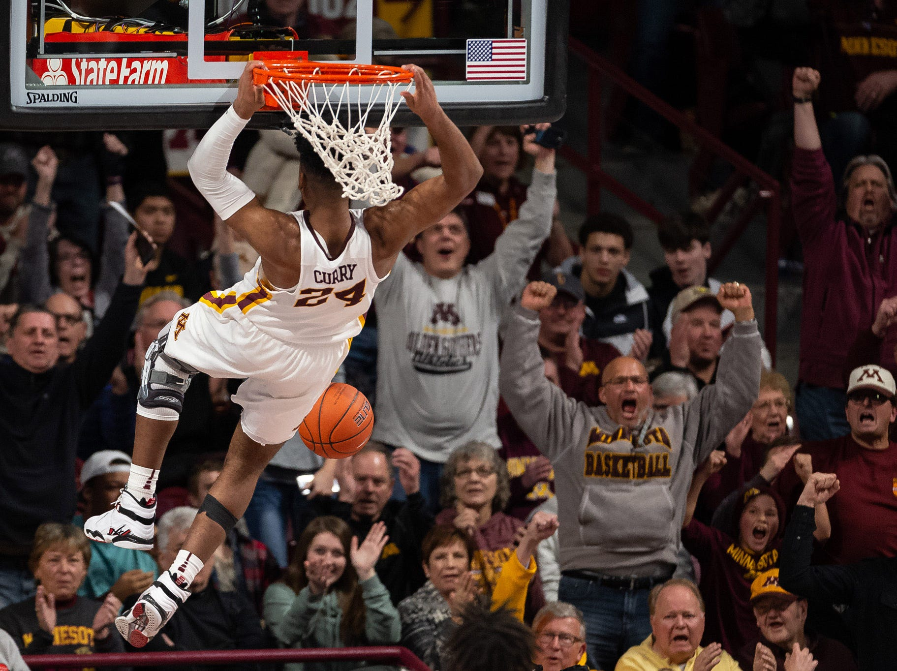 Jan. 27: Minnesota Golden Gophers forward Eric Curry (24) dunks the ball during the second half against the Iowa Hawkeyes at Williams Arena.