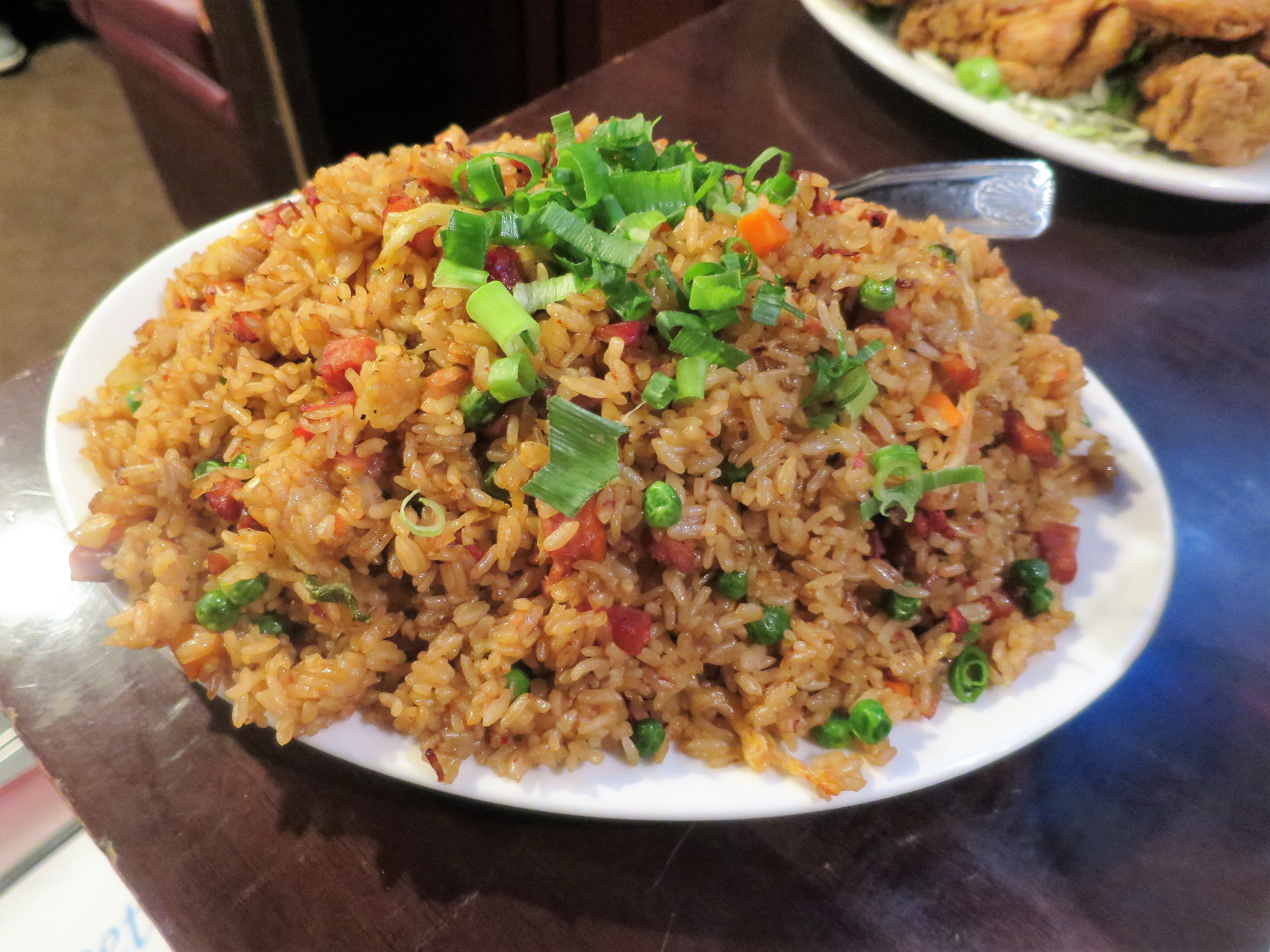 A closer look at the famous fried rice, with bacon, char siu Chinese roast pork, Portuguese sausage and Chinese sausage, plus spicy kimchee, peas, carrots and green onions.