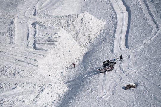 Rescue crews work on the avalanche site of Crans-Montana, Switzerland, Feb. 20, 2019.