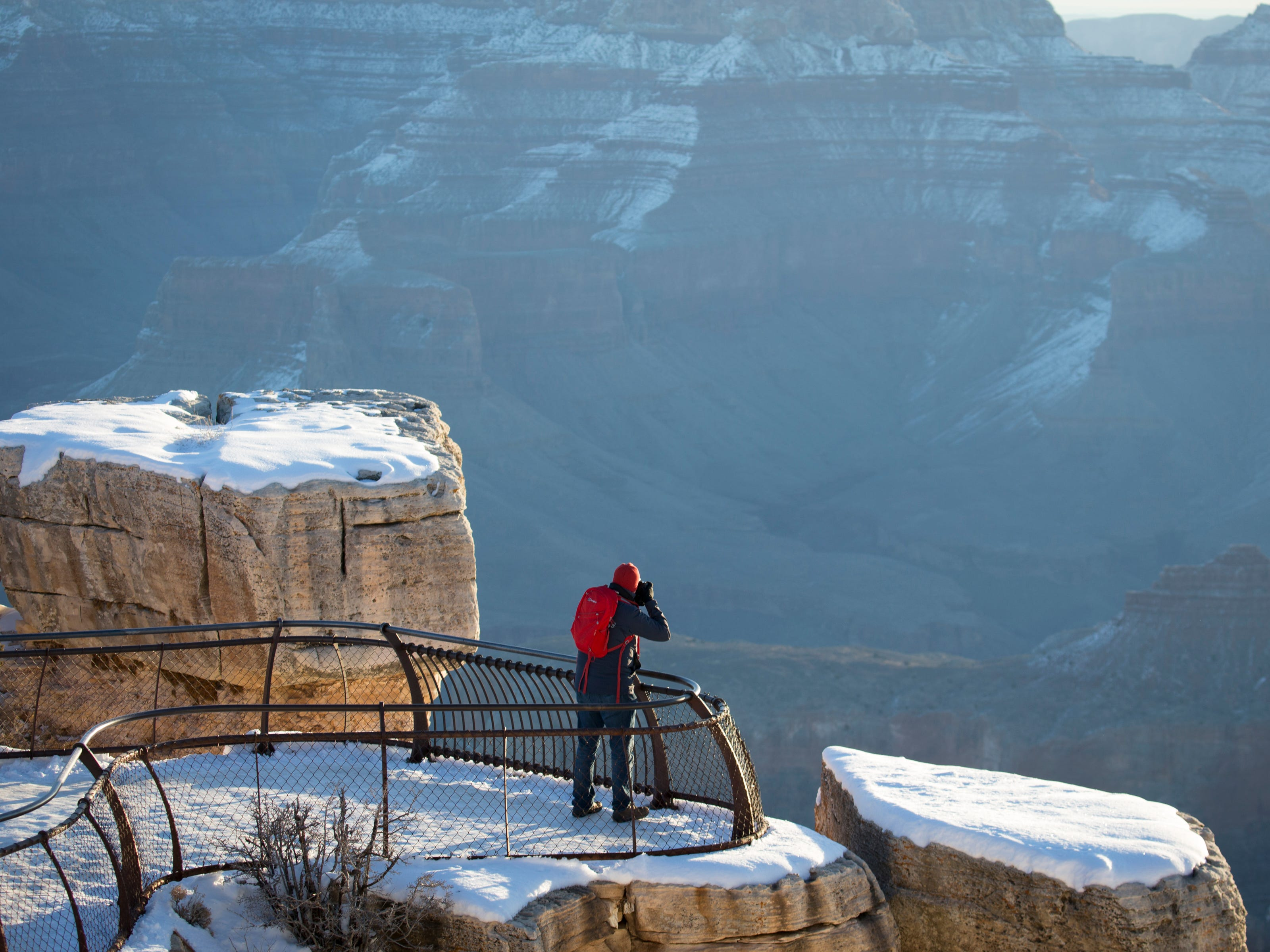 There is snow at sunrise at Mather Point at the South Rim of Grand Canyon National Park in Arizona, Feb. 20, 2019,