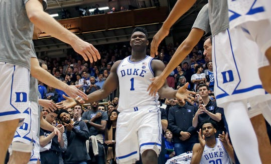 Duke's Zion Williamson (1) is greeted by teammates as he is introduced before the start of a game this season.