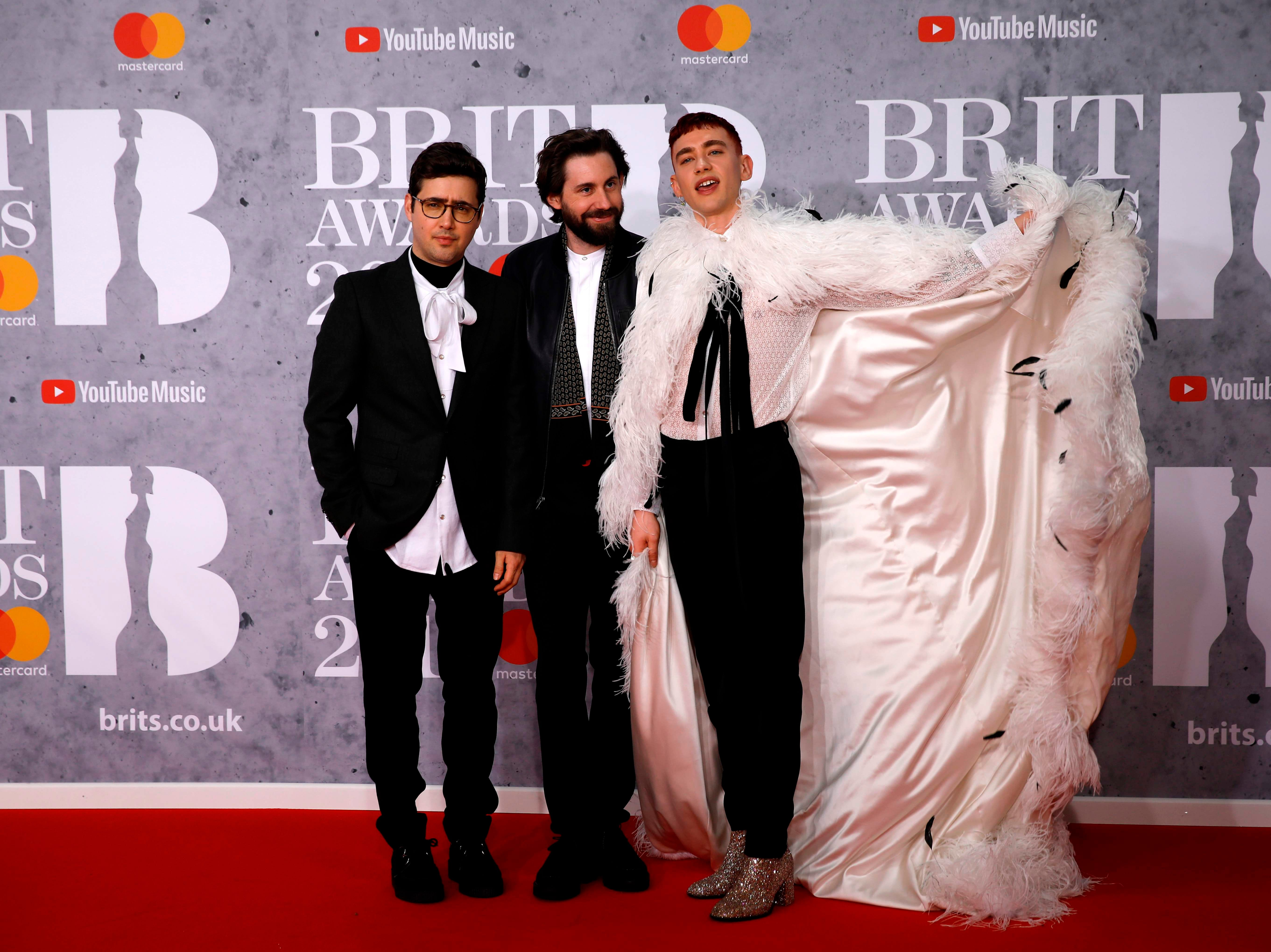 British group 'Years & Years', Olly Alexander, Mikey Goldsworthy and Emre Turkmen pose on the red carpet on arrival for the BRIT Awards 2019 in London on February 20, 2019. (Photo by Tolga AKMEN / AFP) / RESTRICTED TO EDITORIAL USE  NO POSTERS  NO MERCHANDISE NO USE IN PUBLICATIONS DEVOTED TO ARTISTSTOLGA AKMEN/AFP/Getty Images ORIG FILE ID: AFP_1DO1CR