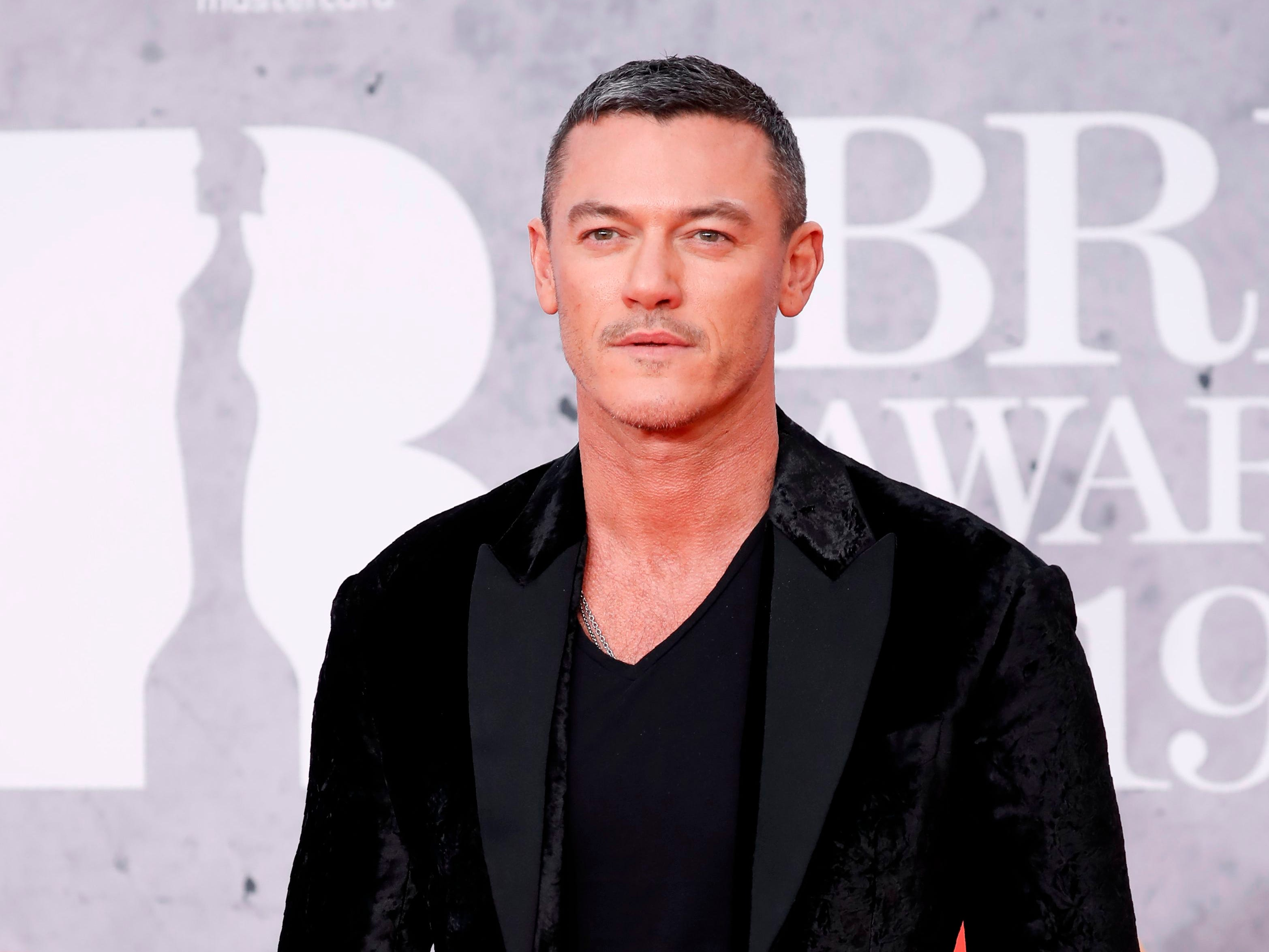British actor Luke Evans poses on the red carpet on arrival for the BRIT Awards 2019 in London on February 20, 2019. (Photo by Tolga AKMEN / AFP) / RESTRICTED TO EDITORIAL USE  NO POSTERS  NO MERCHANDISE NO USE IN PUBLICATIONS DEVOTED TO ARTISTSTOLGA AKMEN/AFP/Getty Images ORG XMIT: 712 ORIG FILE ID: AFP_1DO08E