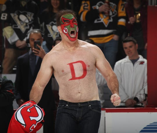 Actor Patrick Warburton, aka David Puddy from Seinfeld, appears at a New Jersey Devils game.