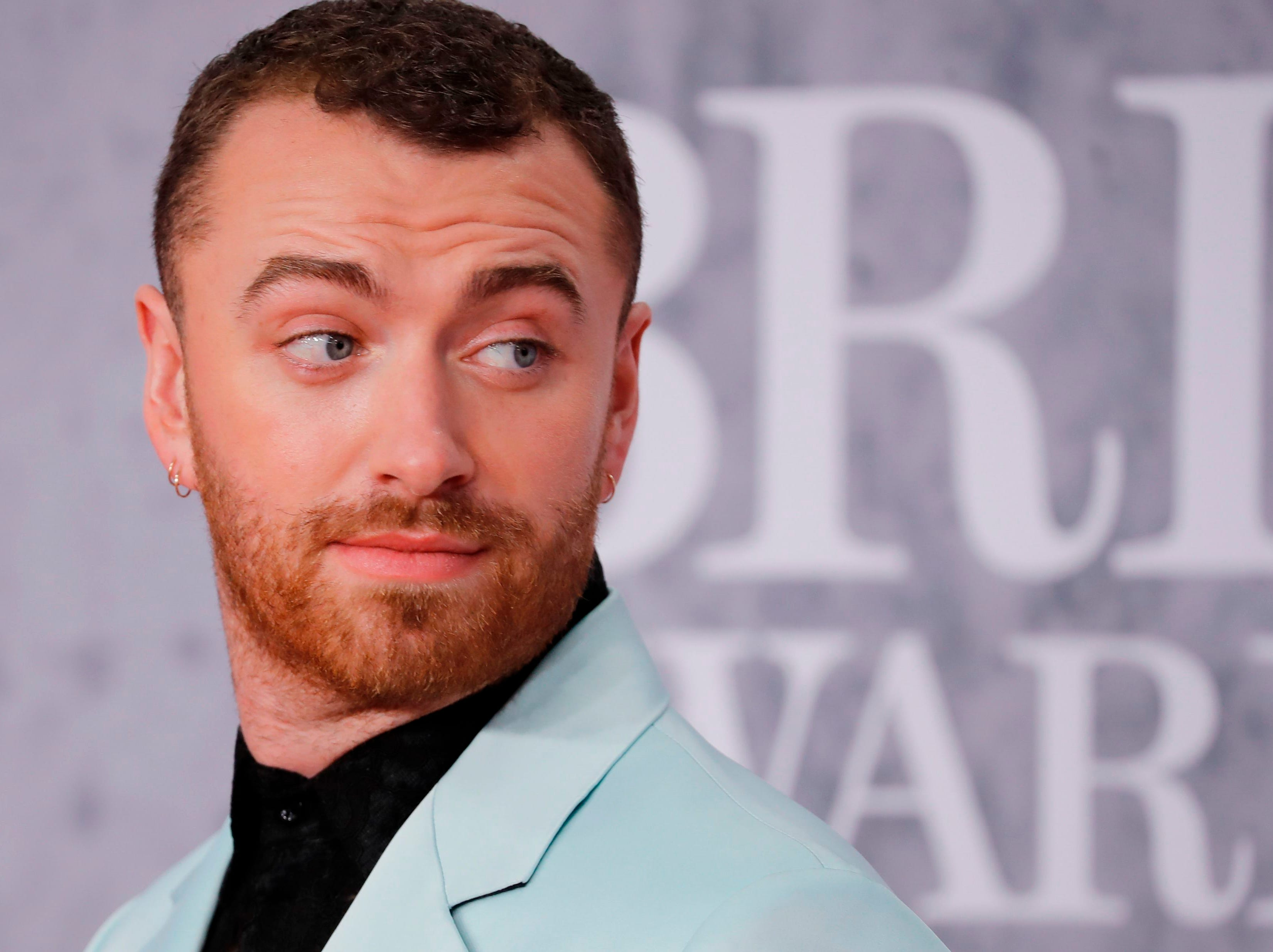 British singer-songwriter Sam Smith poses on the red carpet on arrival for the BRIT Awards 2019 in London on February 20, 2019. (Photo by Tolga AKMEN / AFP) / RESTRICTED TO EDITORIAL USE  NO POSTERS  NO MERCHANDISE NO USE IN PUBLICATIONS DEVOTED TO ARTISTSTOLGA AKMEN/AFP/Getty Images ORIG FILE ID: AFP_1DO0WF