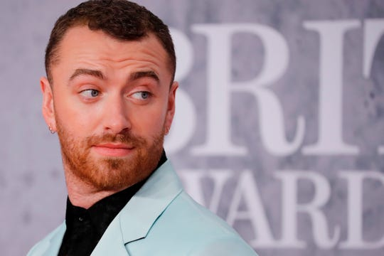 """British singer-songwriter Sam Smith wrote on social media Friday, """"I've decided I am changing my pronouns to THEY/THEM."""""""