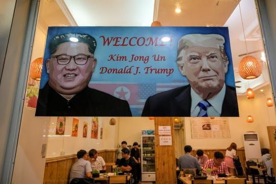 A signboard welcomes the summit between President Donald Trump and North Korean leader Kim Jong Un in Hanoi, Vietnam.