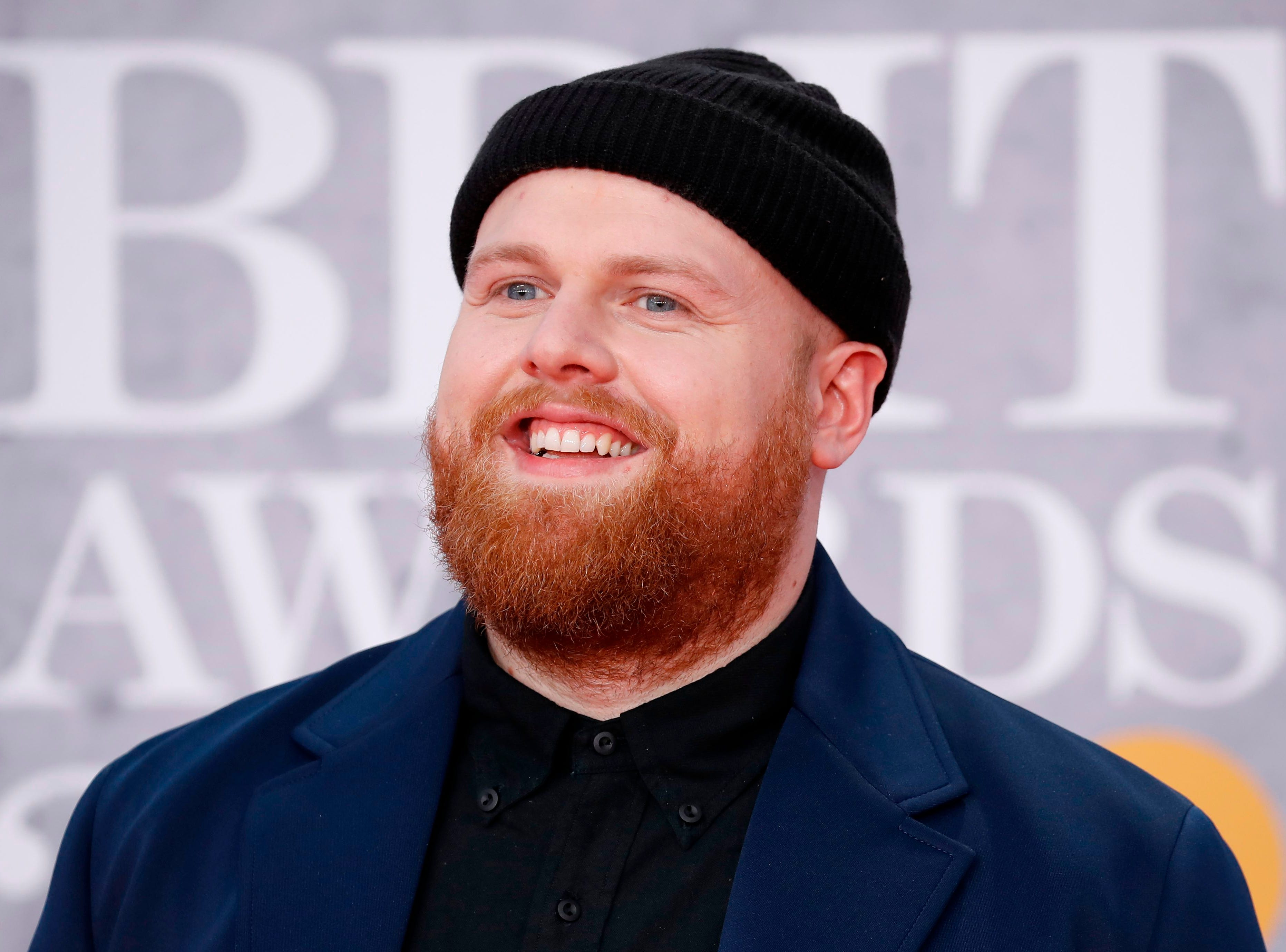 British singer-songerwriter Tom Walker poses on the red carpet on arrival for the BRIT Awards 2019 in London on February 20, 2019. (Photo by Tolga AKMEN / AFP) / RESTRICTED TO EDITORIAL USE  NO POSTERS  NO MERCHANDISE NO USE IN PUBLICATIONS DEVOTED TO ARTISTSTOLGA AKMEN/AFP/Getty Images ORIG FILE ID: AFP_1DN9RQ
