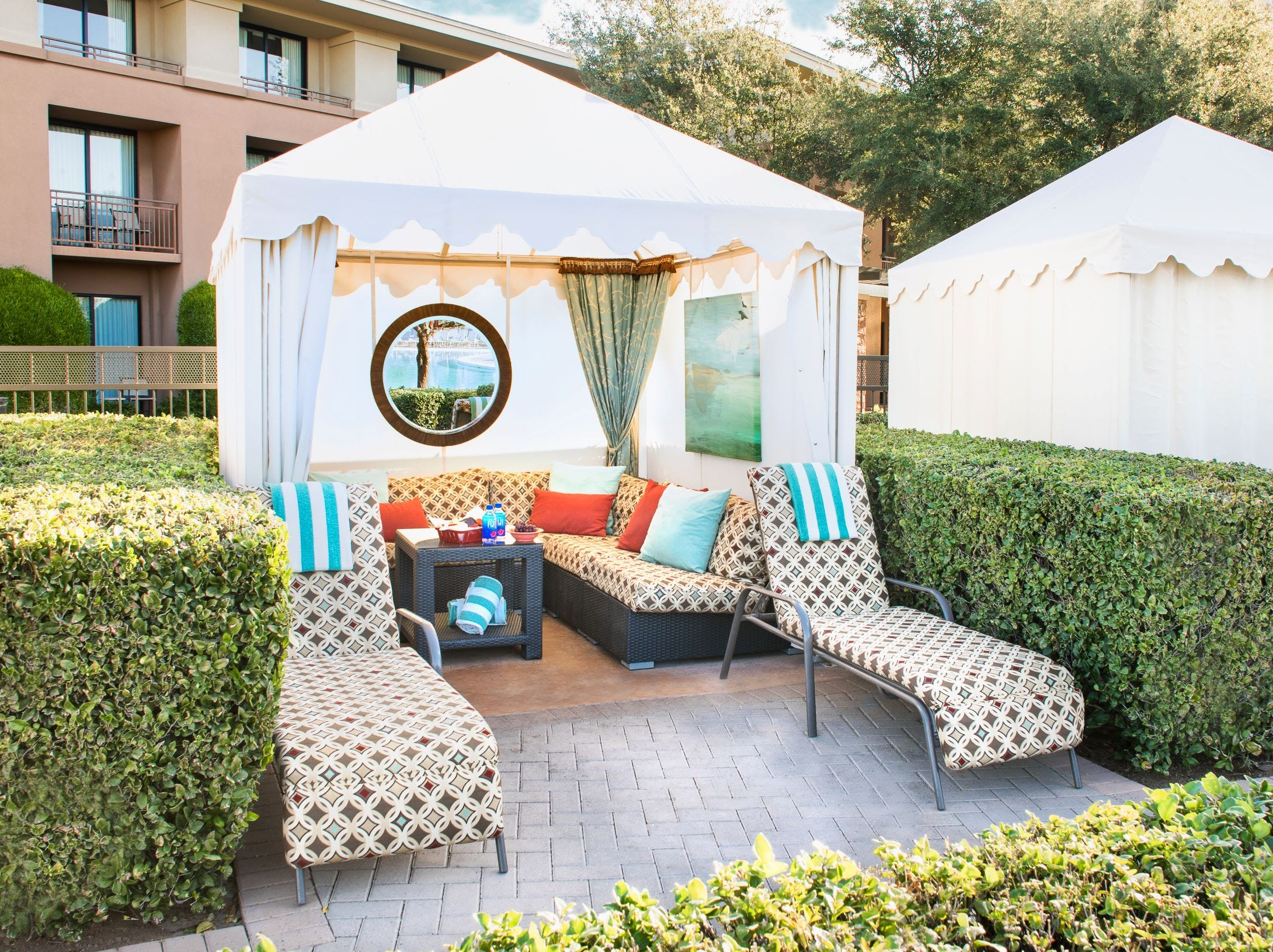 A premium poolside cabana at the Westin Kierland Resort & Spa in Phoenix,  which rents for $100 to $400 a day, includes a sofa, love seats, ceilng fan, frozen grapes, chips and salsa and Fiji water.