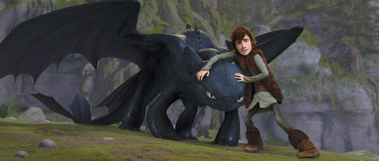 """Hiccup (voiced by Jay Baruchel) protects an injured Toothless in """"How to Train Your Dragon."""""""