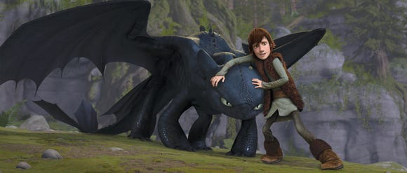 "Hiccup (voiced by Jay Baruchel)  protects an injured Toothless in the original 2010 ""How to Train Your Dragon."""