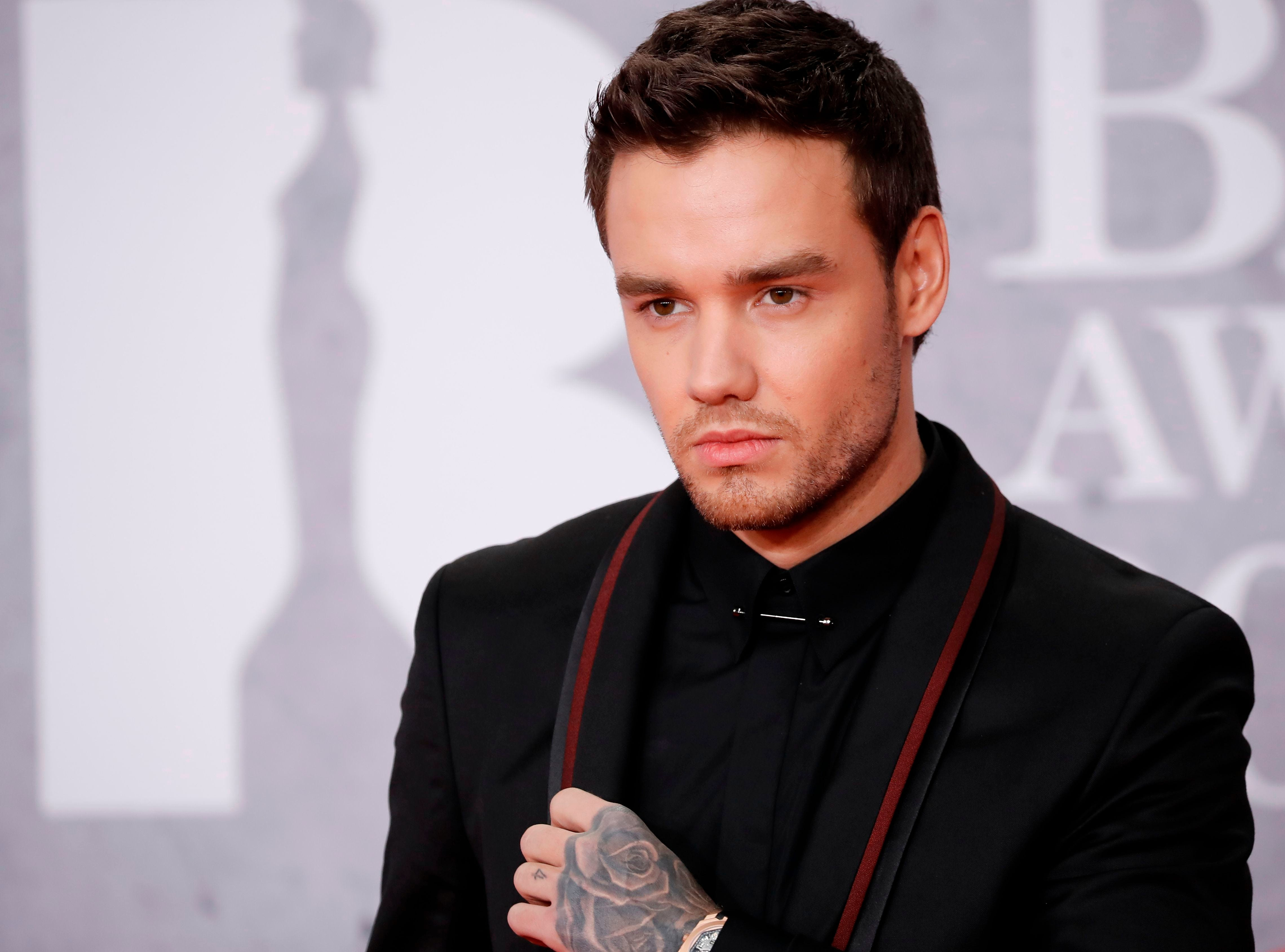 Liam British singer-songwriter Liam Payne poses on the red carpet on arrival for the BRIT Awards 2019 in London on February 20, 2019. (Photo by Tolga AKMEN / AFP) / RESTRICTED TO EDITORIAL USE  NO POSTERS  NO MERCHANDISE NO USE IN PUBLICATIONS DEVOTED TO ARTISTSTOLGA AKMEN/AFP/Getty Images ORIG FILE ID: AFP_1DO1PL