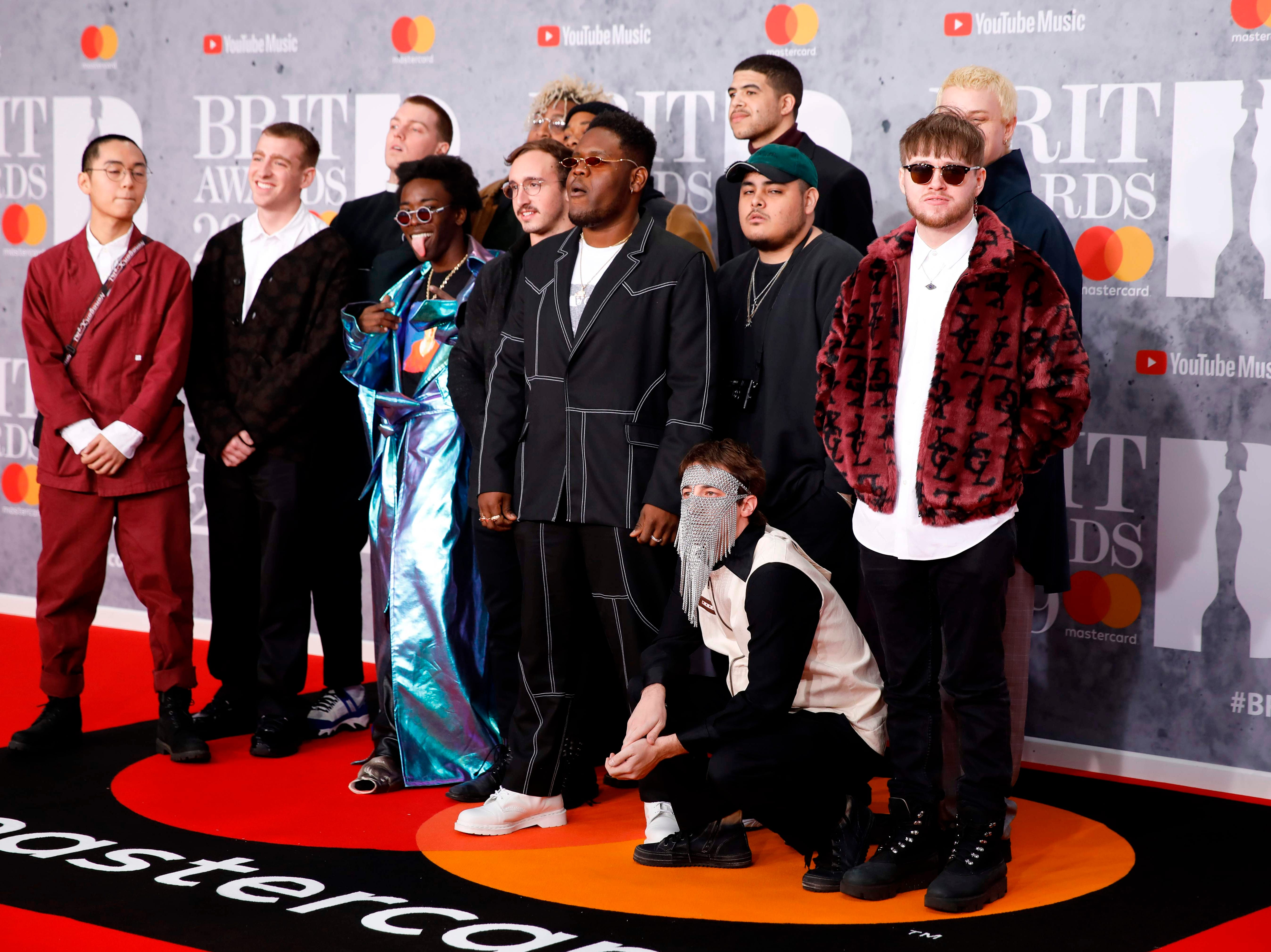 US music collective 'Brockhampton' pose on the red carpet on arrival for the BRIT Awards 2019 in London on February 20, 2019. (Photo by Tolga AKMEN / AFP) / RESTRICTED TO EDITORIAL USE  NO POSTERS  NO MERCHANDISE NO USE IN PUBLICATIONS DEVOTED TO ARTISTSTOLGA AKMEN/AFP/Getty Images ORIG FILE ID: AFP_1DO0VR