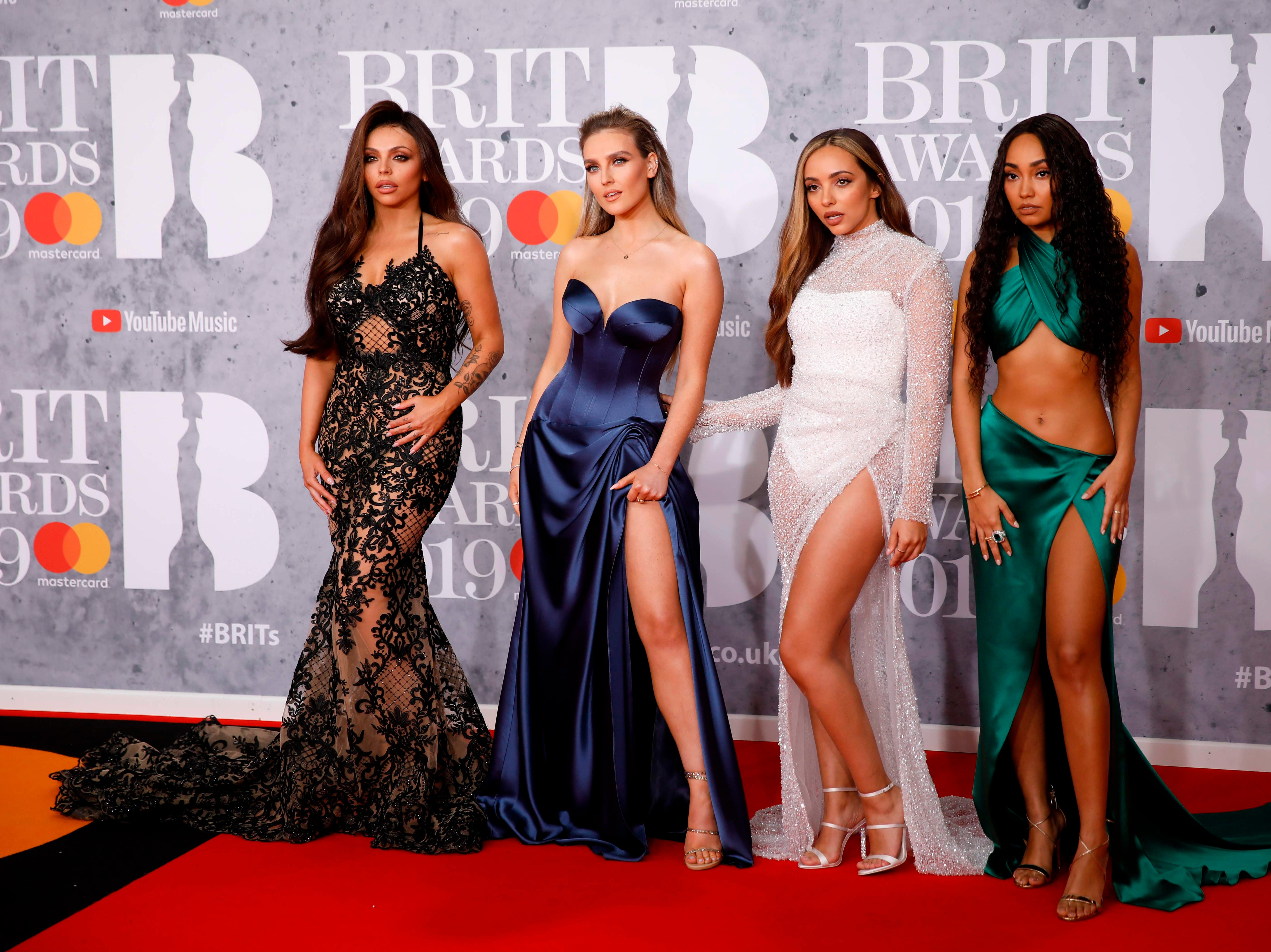 British girl group 'Little Mix', Perrie Edwards, Jesy Nelson, Jade Thirlwall and Leigh-Anne Pinnock pose on the red carpet on arrival for the BRIT Awards 2019 in London on February 20, 2019. (Photo by Tolga AKMEN / AFP) / RESTRICTED TO EDITORIAL USE  NO POSTERS  NO MERCHANDISE NO USE IN PUBLICATIONS DEVOTED TO ARTISTSTOLGA AKMEN/AFP/Getty Images ORIG FILE ID: AFP_1DO1QF