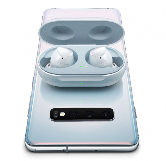 Samsung Galaxy Buds charging wirelessly from a Galaxy S10+.