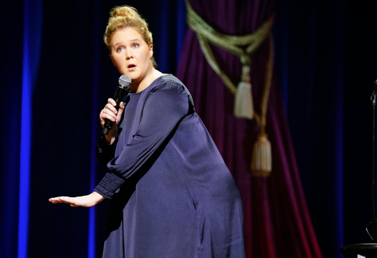 "Amy Schumer talks about marriage and pregnancy in stand-up special ""Growing."""