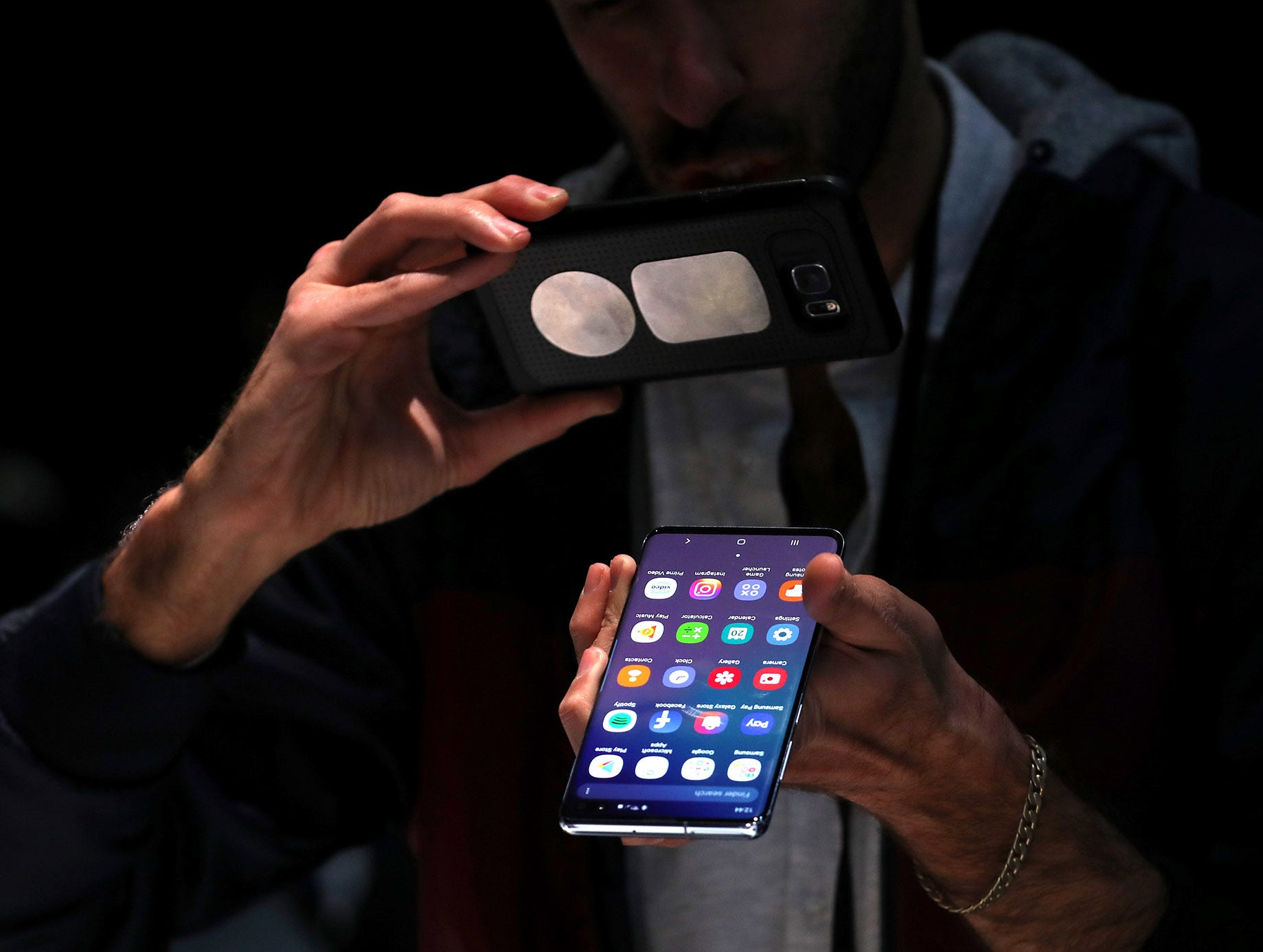 An attendee looks at a new Samsung Galaxy S10 smartphone during the Samsung Unpacked event on Feb. 20, 2019 in San Francisco, Calif.
