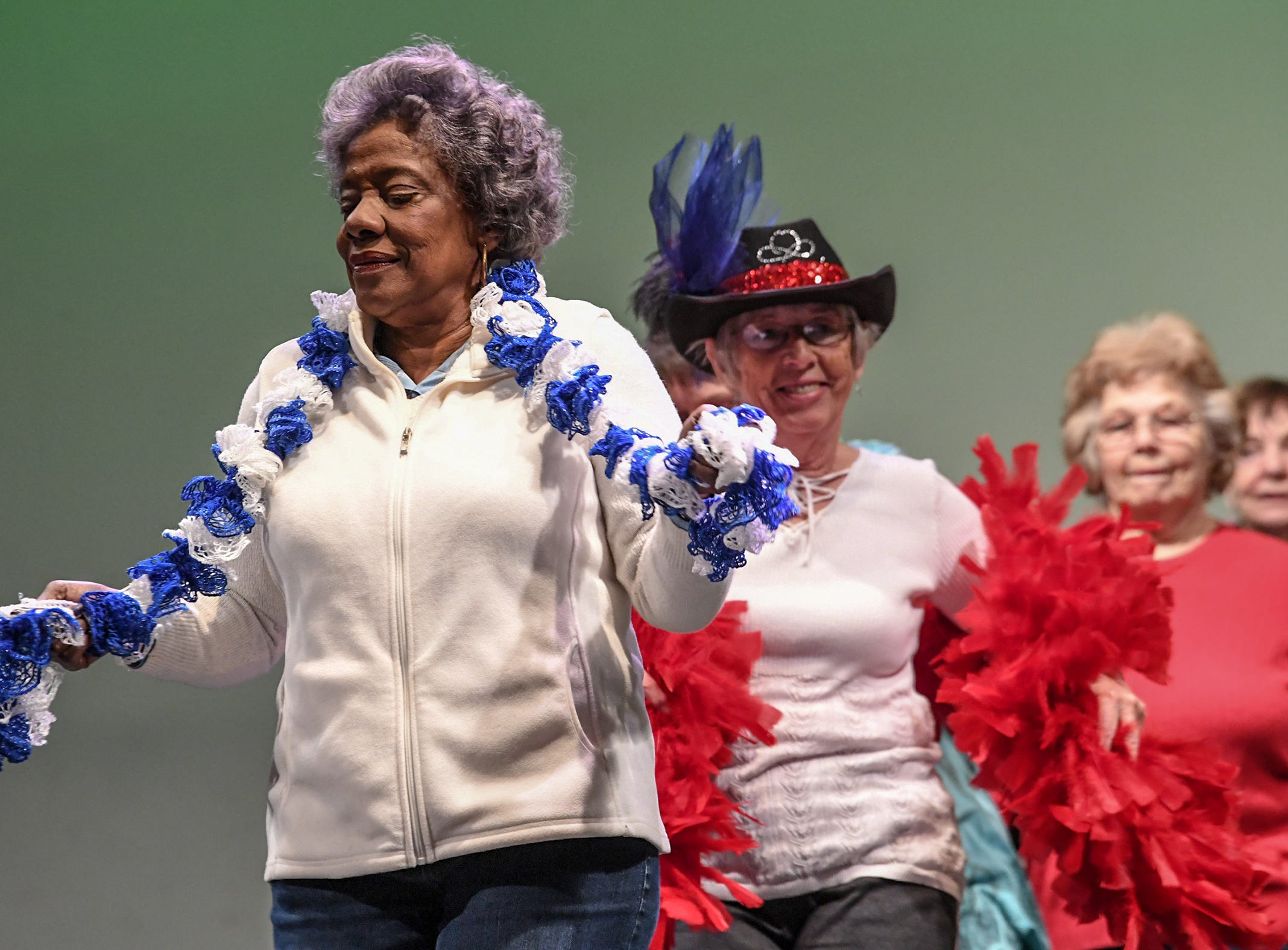 "Florence Reid, left, and Sue Carpenter, right, and Anderson Senior Follies performers rehearse at the Anderson University Fine Arts Center's Henderson Auditorium in February. The show titled ""A Class Act"" is led by retiring director Annette Martin and incoming director Mary Nickles. Martin said the show is a whimsical look at being a senior, with vintage, patriotic, and classy people. The five shows are at the auditorium March 14-17, 2019."