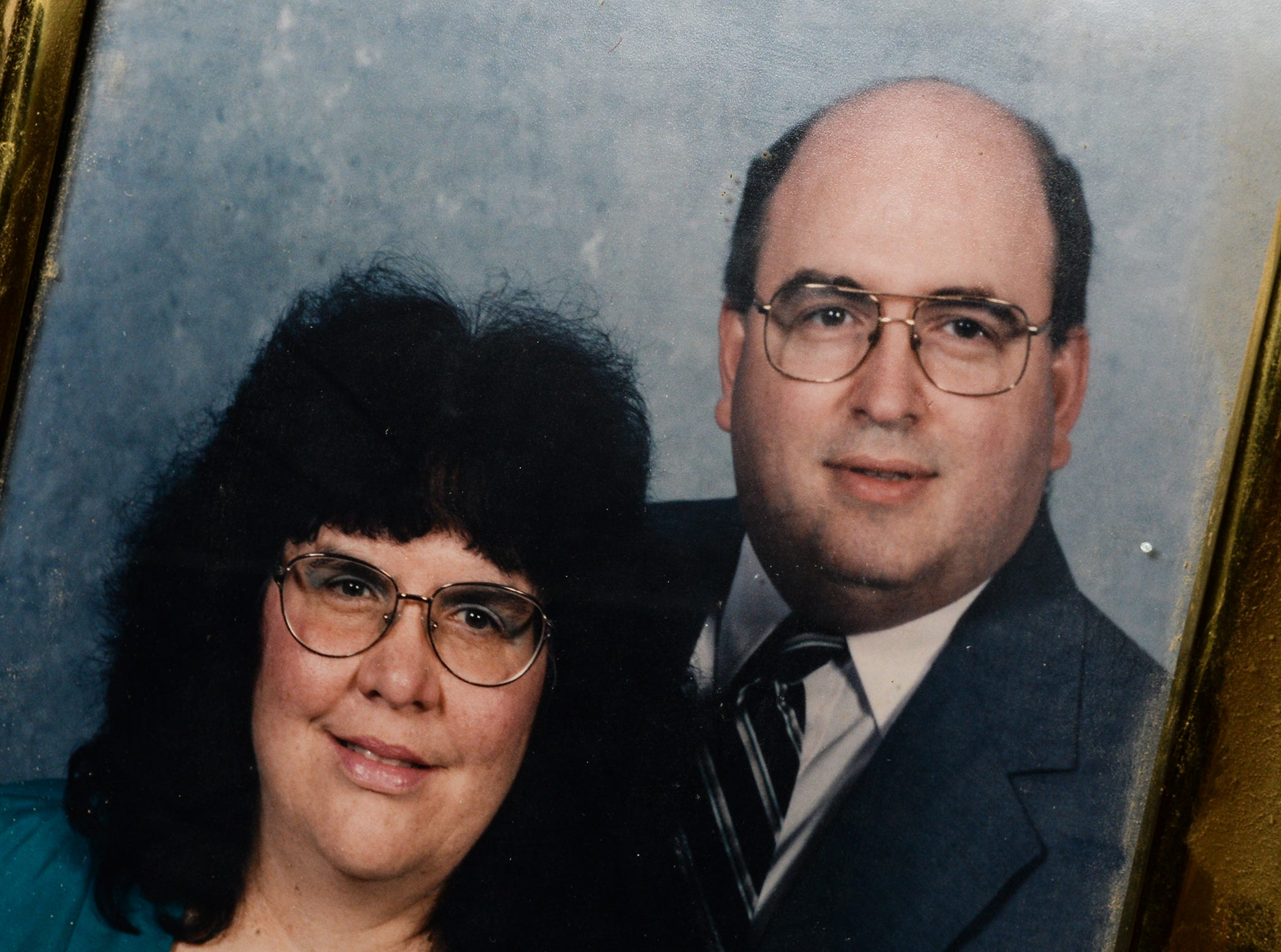 A framed family photo of Richard and Linda Dupont of Easley at her home.