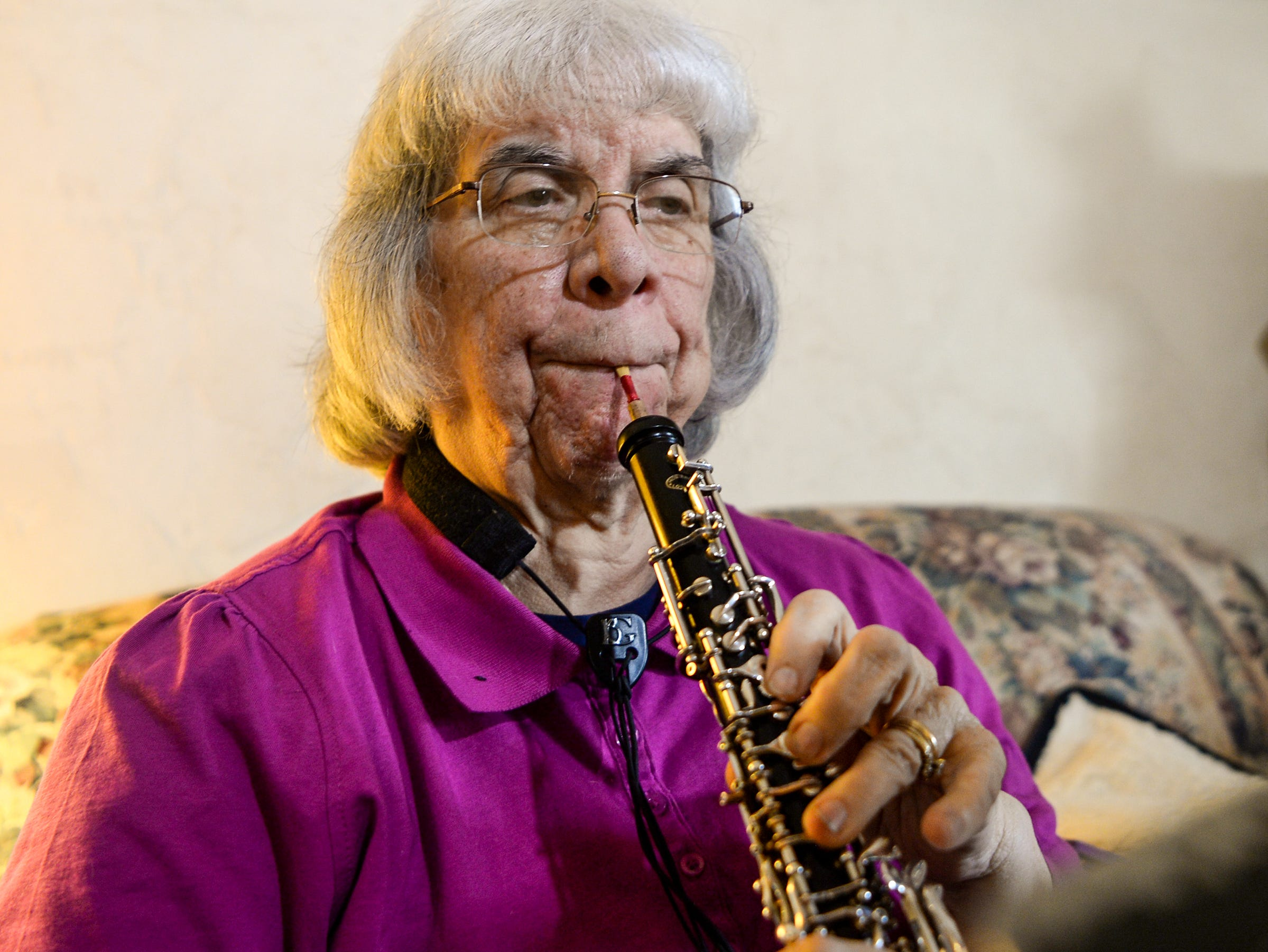 Linda Dupont of Easley plays her obo at her home in February, something she says helps her as she copes with the loss of her husband Richard. Dupont says she misses him after he died during a rehearsal with the Anderson Symphony Orchestra, and grateful for the group helping her in her time of need.