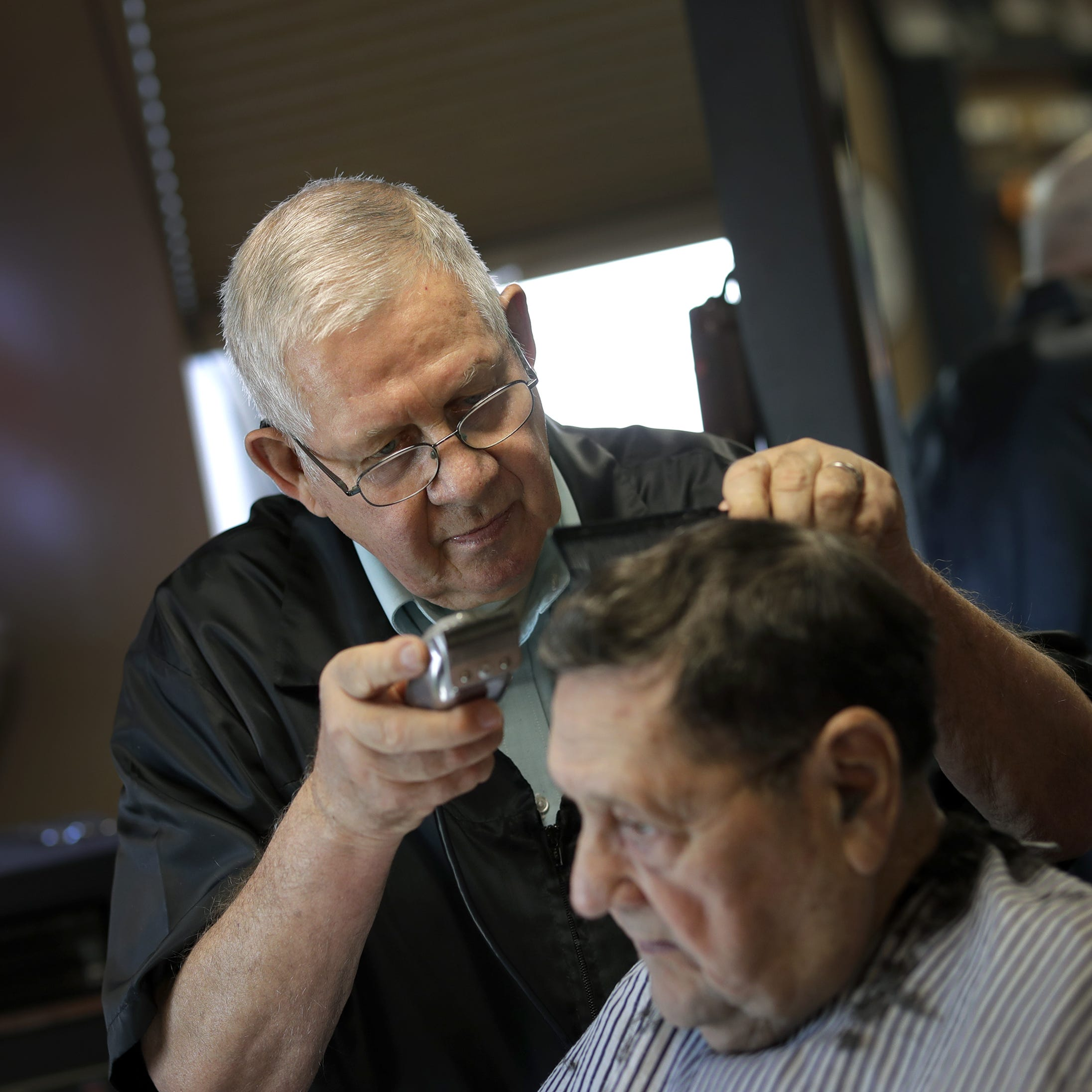 Into their 80s, pair of Greasy Fingers barbers just keep clippin' along