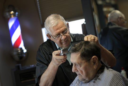 Don Klemp, 80, cuts the hair of Bud Boldig of Menasha at Greasy Fingers barbershop Tuesday in Appleton. Boldig has been a customer for more than 20 years.