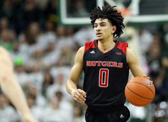 Feb 20, 2019; East Lansing, MI, USA; Rutgers Scarlet Knights guard Geo Baker (0) brings the ball up court during the first half of a game against the Michigan State Spartans at the Breslin Center.