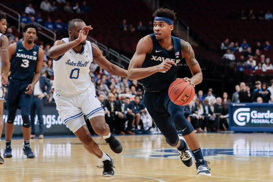 Feb 20, 2019; Newark, NJ, USA; Xavier Musketeers guard Paul Scruggs (1) dribbles the ball as Seton Hall Pirates guard Quincy McKnight (0) defends during the first half at Prudential Center.