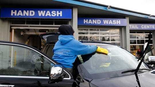 A car is cleaned at ProShine Hand Car Wash and Detail Center in Eatontown Monday, February 18, 2019.