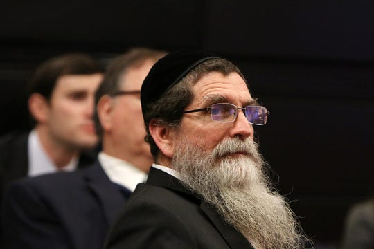 Rabbi Osher Eisemann, the founder of Lakewood's School for Children with Hidden Intelligence who is accused of diverting nearly $1 million meant to educate special needs students to his own interests, listens to closing statements during trial before Superior Court Judge Benjamin Bucca Jr. at the Middlesex County Courthouse in New Brunswick, NJ Thursday, February 21, 2019.