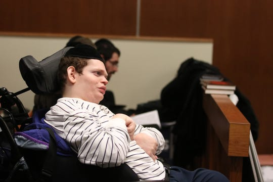Eliezer Eisemann, son of Rabbi Osher Eisemann, the founder of Lakewood's School for Children with Hidden Intelligence who is accused of diverting nearly $1 million meant to educate special needs students to his own interests, listens to closing statements during his father's trial before Superior Court Judge Benjamin Bucca Jr. at the Middlesex County Courthouse in New Brunswick, NJ Thursday, February 21, 2019.