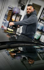 ProShine Hand Car Wash and Detail Center owner William Rodriguez prepares to buff a car at the Eatontown business Monday, February 18, 2019.