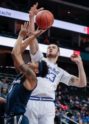 Seton Hall Pirates forward Sandro Mamukelashvili (23) blocks a shot by Xavier Musketeers guard Paul Scruggs (1)