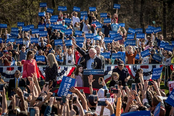 "PROSPECT PARK, BROOKLYN, NEW YORK, UNITED STATES - 2016/04/17: More than 28,000 people flooded Brooklyn's Prospect Park for Presidential candidate Bernie Sanders.  The campaign called it his biggest rally yet.  Guests included the indie band Grizzly Bear, Danny Devito, Justin Long and  Rep. Tulsi Gabbard, D-Hawaii, and Brooklyn Councilman Jumaane Williams, an Occupy Wall Street activist who revved up the crowd with a ""mic check"". (Photo by Michael Nigro/Pacific Press/LightRocket via Getty Images)"