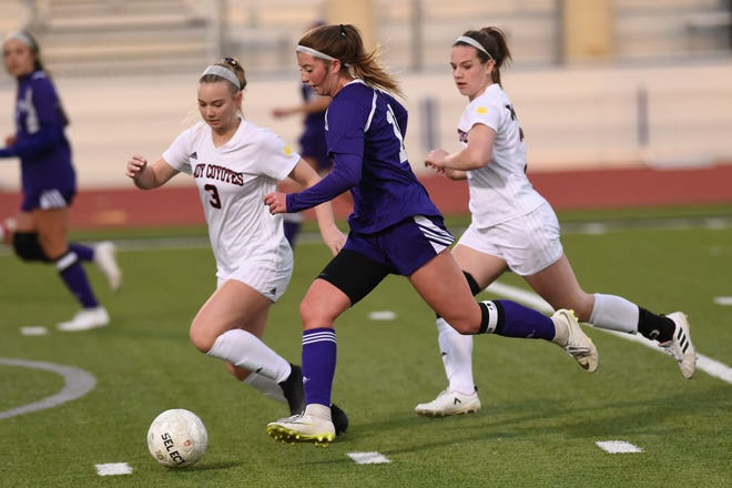 Wylie's Shaelyn Ward (11) dribbles past a pair of Wichita Falls High defenders at Bulldog Stadium on Wednesday, Feb. 20, 2019. The Lady Bulldogs fell 4-2 in penalty kicks after tying 1-1 in regulation.