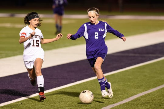 Wylie's Morgan Travis (2) carries the ball down the sideline against Wichita Falls High during a 2019 game. Travis scored two goals in a 3-1 win against Cooper and added an assist against Aledo to be named Abilene Reporter-News Local Player of the Week for the week ending Feb. 29.