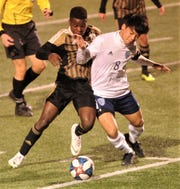 Hust Bell's Zaiden Kethavong, right, fights Abilene High's Bernard Kamungo for the ball. Bell beat the Eagles 1-0 in the District 3-6A game Feb. 20 at Shotwell Stadium.