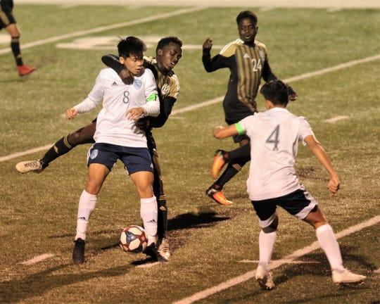 An Abilene High player battles Hurst Bell's Zaiden Kethavong (8) for the ball while AHS' Dieduonne Miruho (24) and Bell's Eric Escobedo (4) look on. Bell beat the Eagles 1-0 in the District 3-6A game Wednesday, Feb. 20, 2019, at Shotwell Stadium.